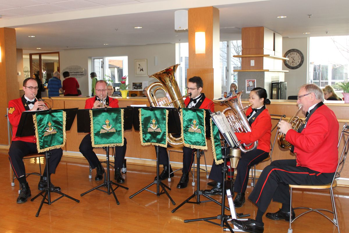 Formal band playing music for residents
