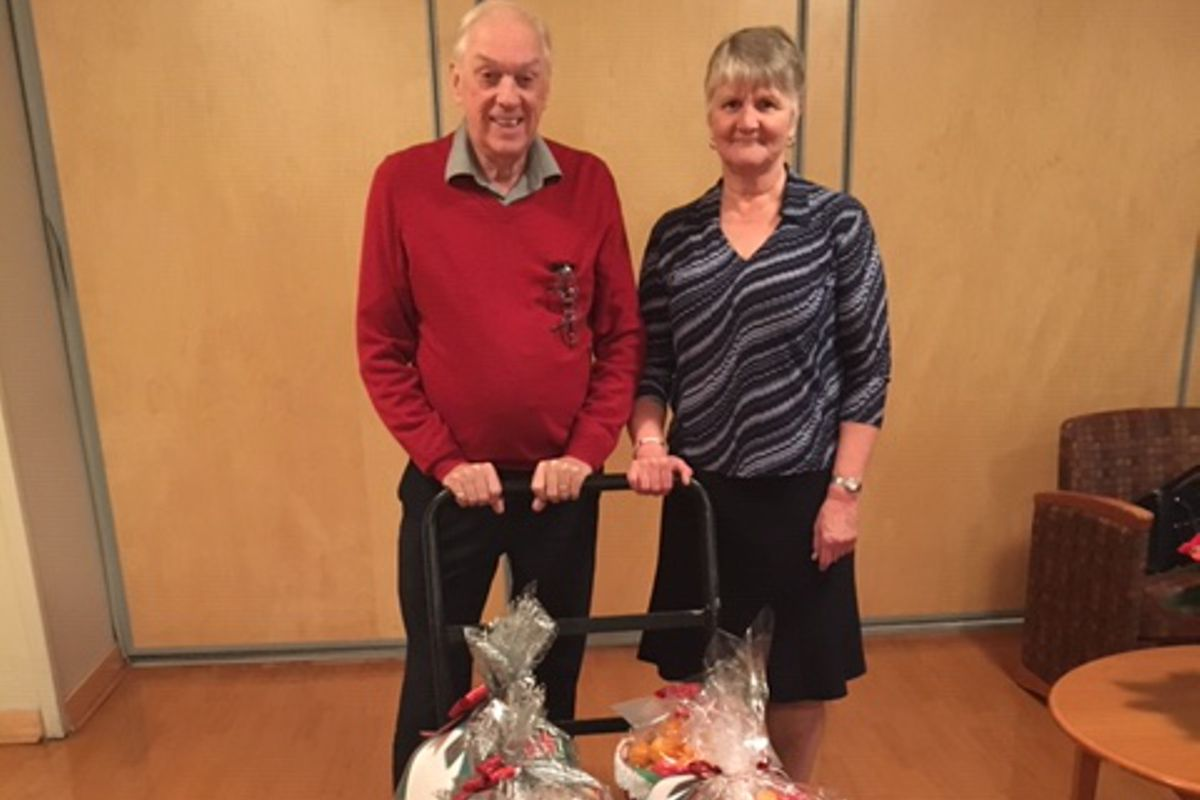 Residents posing with gift baskets